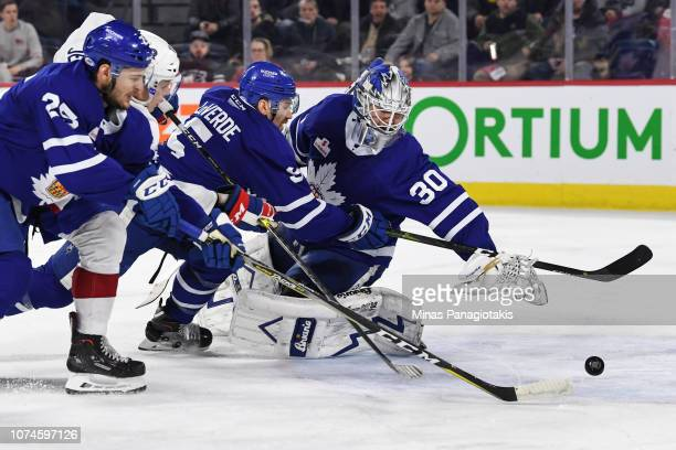 Goaltender Kasimir Kaskisuo of Toronto Marlies reaches behind him for the puck against the Laval Rocket during the AHL game at Place Bell on December...
