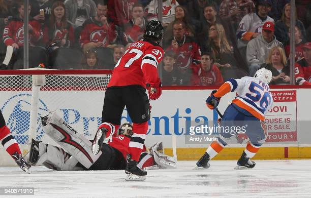 Goaltender Keith Kinkaid of the New Jersey Devils can't stop a goal by Tanner Fritz of the New York Islanders during the game at Prudential Center on...