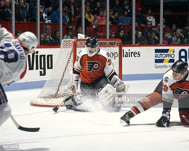 Goaltender Ken Wregget of the Philadelphia Flyers protects the net against Denis Savard of the Montreal Canadiens in the early 1990's at the Montreal...