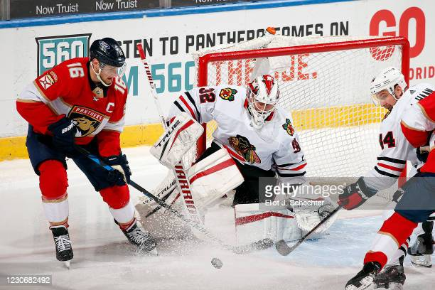 Goaltender Kevin Lankinen of the Chicago Blackhawks defends the net against Aleksander Barkov of the Florida Panthers at the BB&T Center on...