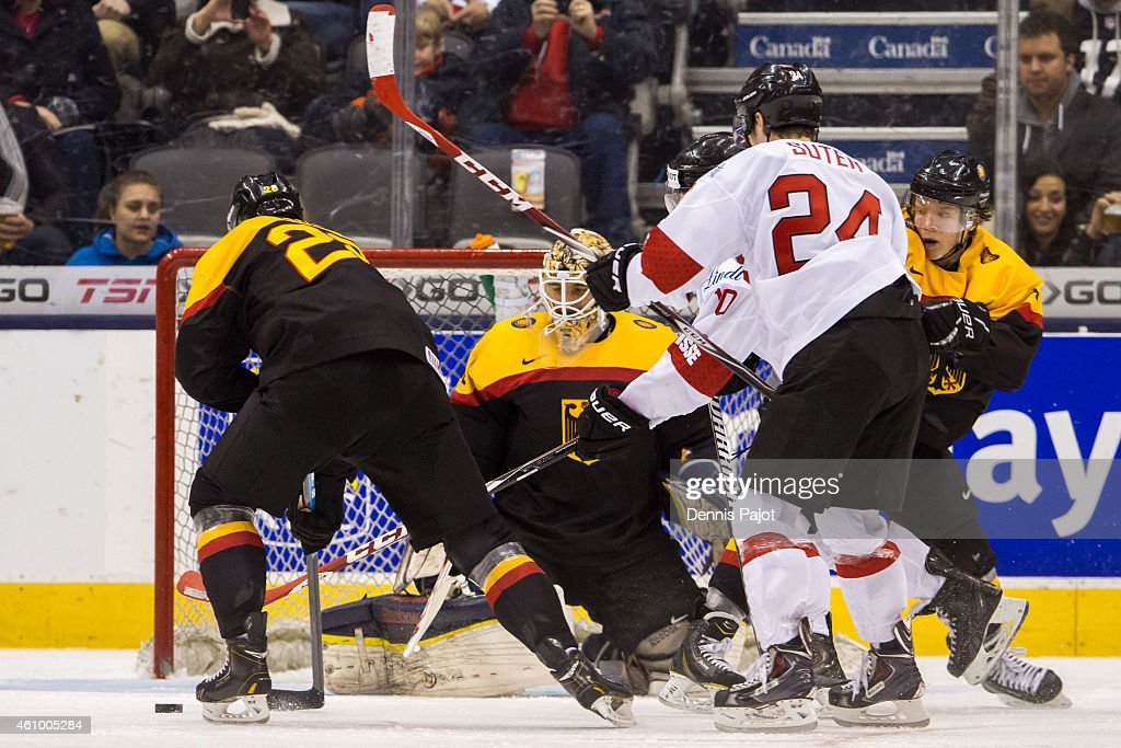Goaltender Kevin Reich #30 of Germany makes a tremendous save against forward Pius Suter #24 of Switzerland during the 2015 IIHF World Junior Championship on January 03, 2015 at the Air Canada Centre in Toronto, Ontario, Canada.