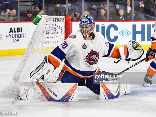 Goaltender Kristers Gudlevskis of the Bridgeport Sound Tigers protects his net against the Laval Rocket during the AHL game at Place Bell on March 2...