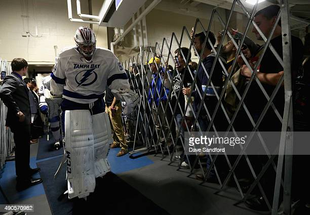Goaltender Kristers Gudlevskis of the Tampa Bay Lightning walks to the ice to play in the NHL Kraft Hockeyville USA preseason game against the...