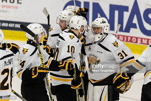 Goaltender Kyle Jessiman of the Cape Breton Screaming Eagles celebrates a victory with teammates during the QMJHL game against the...