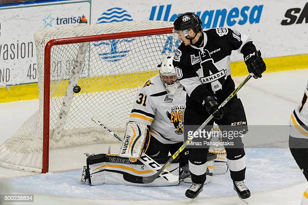 Goaltender Kyle Jessiman of the Cape Breton Screaming Eagles allows a goal while being screened by Alexandre DelisleHoude of the BlainvilleBoisbriand...