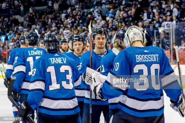 Goaltender Laurent Brossoit of the Winnipeg Jets gets congratulated by teammates following a 53 victory over the Arizona Coyotes at the Bell MTS...