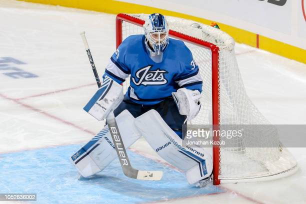 Goaltender Laurent Brossoit of the Winnipeg Jets guards the net during second period action against the Arizona Coyotes at the Bell MTS Place on...