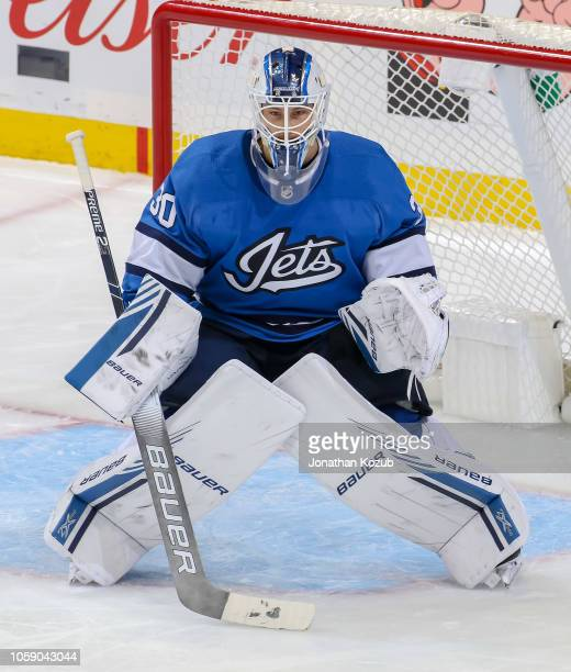 Goaltender Laurent Brossoit of the Winnipeg Jets guards the net during third period action against the Arizona Coyotes at the Bell MTS Place on...