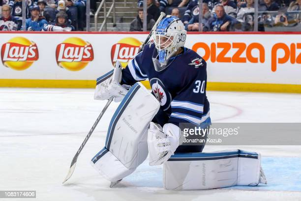 Goaltender Laurent Brossoit of the Winnipeg Jets guards the net during first period action against the Vegas Golden Knights at the Bell MTS Place on...