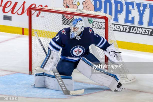 Goaltender Laurent Brossoit of the Winnipeg Jets guards the net during third period action against the Vegas Golden Knights at the Bell MTS Place on...