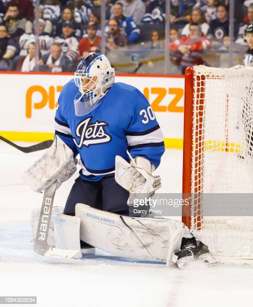 Goaltender Laurent Brossoit of the Winnipeg Jets guards the net during third period action against the Detroit Red Wings at the Bell MTS Place on...
