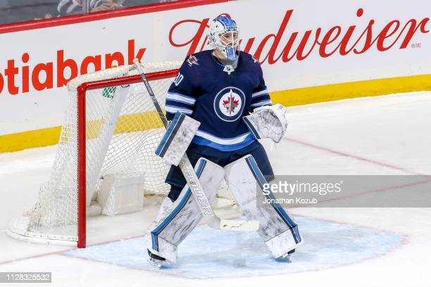 Goaltender Laurent Brossoit of the Winnipeg Jets guards the net during second period action against the Nashville Predators at the Bell MTS Place on...
