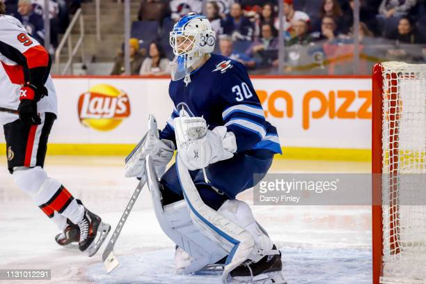 Goaltender Laurent Brossoit of the Winnipeg Jets guards the net during third period action against the Ottawa Senators at the Bell MTS Place on...