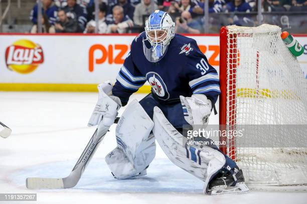 Goaltender Laurent Brossoit of the Winnipeg Jets guards the net during third period action against the Toronto Maple Leafs at the Bell MTS Place on...