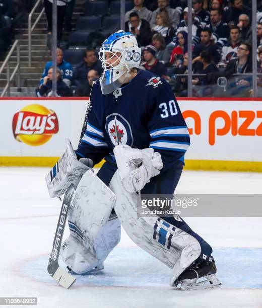Goaltender Laurent Brossoit of the Winnipeg Jets guards the net during first period action against the Detroit Red Wings at the Bell MTS Place on...