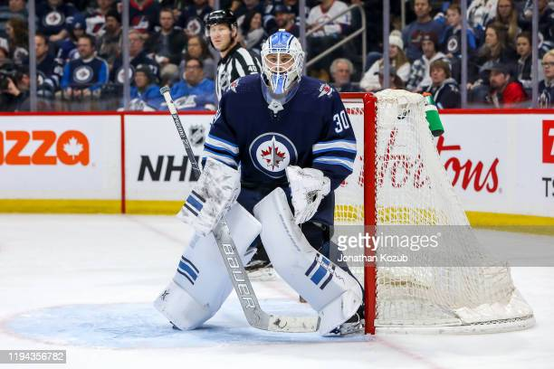Goaltender Laurent Brossoit of the Winnipeg Jets guards the net during second period action against the Tampa Bay Lightning at the Bell MTS Place on...