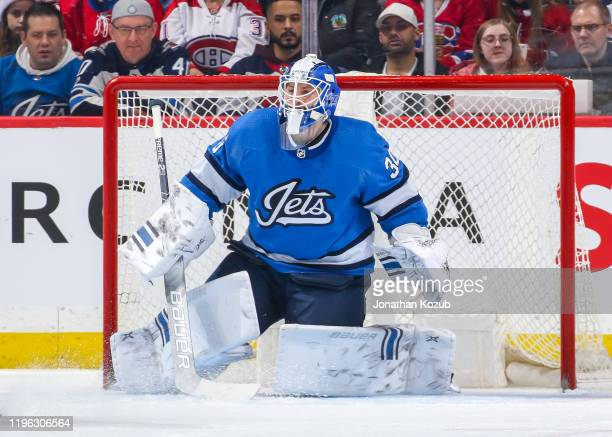 Goaltender Laurent Brossoit of the Winnipeg Jets guards the net during second period action against the Montreal Canadiens at the Bell MTS Place on...