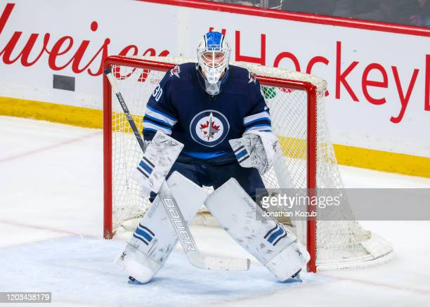Goaltender Laurent Brossoit of the Winnipeg Jets guards the net during first period action against the Boston Bruins at the Bell MTS Place on January...