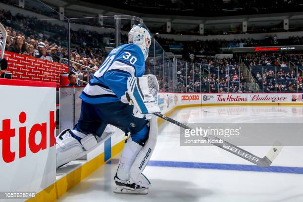 Goaltender Laurent Brossoit of the Winnipeg Jets hits the ice prior to puck drop against the Arizona Coyotes at the Bell MTS Place on October 20 2018...