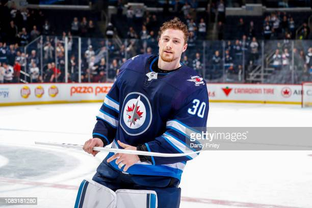 Goaltender Laurent Brossoit of the Winnipeg Jets is all smiles after receiving first star honours following a 41 victory over the Vegas Golden...