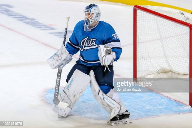 Goaltender Laurent Brossoit of the Winnipeg Jets keeps an eye on the play during second period action against the Carolina Hurricanes at the Bell MTS...