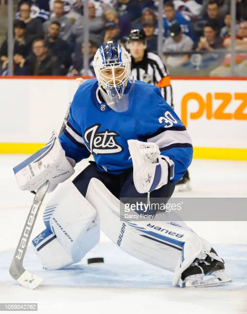 Goaltender Laurent Brossoit of the Winnipeg Jets keeps an eye on the puck during third period action against the Arizona Coyotes at the Bell MTS...