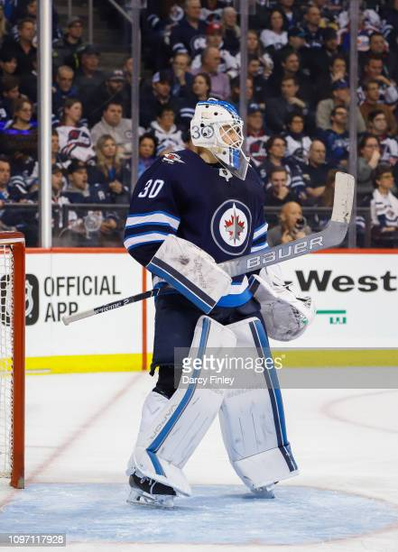 Goaltender Laurent Brossoit of the Winnipeg Jets keeps an eye on the play during third period action against the Vegas Golden Knights at the Bell MTS...