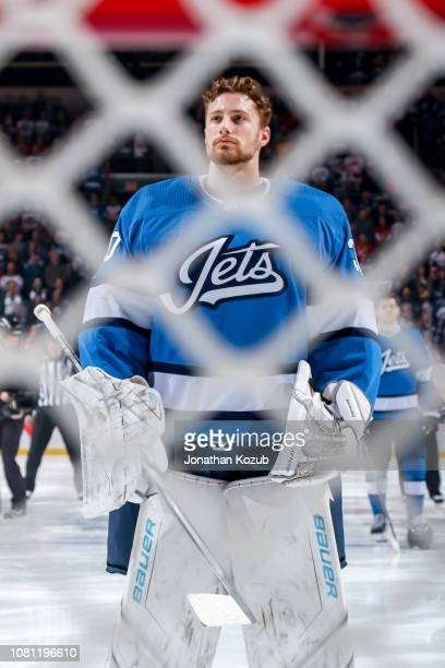 Goaltender Laurent Brossoit of the Winnipeg Jets looks on during the pregame warm up prior to NHL action against the Detroit Red Wings at the Bell...