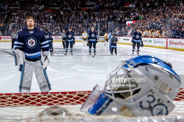 Goaltender Laurent Brossoit of the Winnipeg Jets looks on during the singing of the National anthems prior to puck drop against the Nashville...
