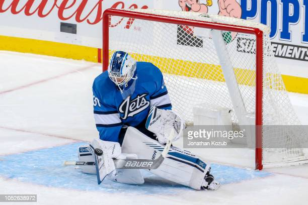 Goaltender Laurent Brossoit of the Winnipeg Jets makes a blocker save during third period action against the Arizona Coyotes at the Bell MTS Place on...
