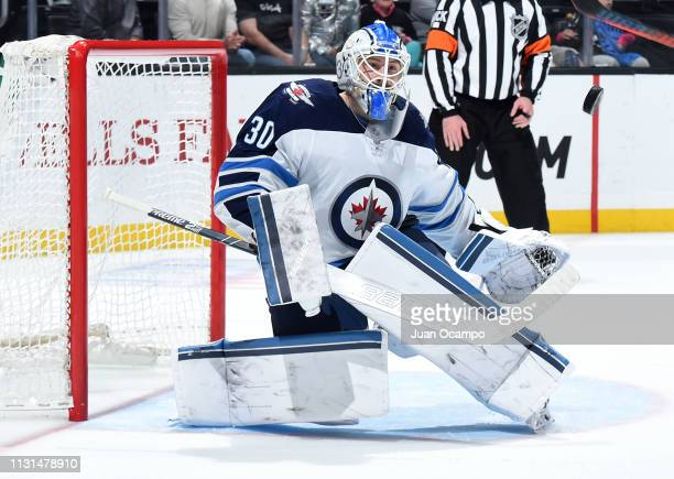 Goaltender Laurent Brossoit of the Winnipeg Jets makes a save during the third period of the game against the Los Angeles Kings at STAPLES Center on...