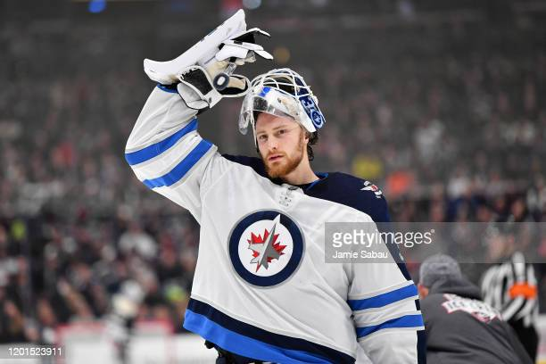 Goaltender Laurent Brossoit of the Winnipeg Jets takes a breather against the Columbus Blue Jackets on January 22 2020 at Nationwide Arena in...
