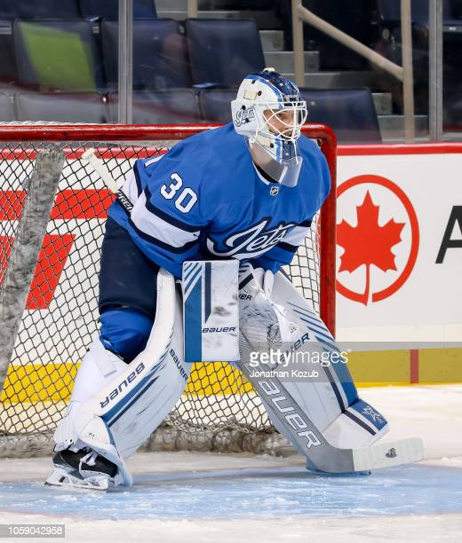 Goaltender Laurent Brossoit of the Winnipeg Jets takes part in the pregame warm up prior to NHL action against the Arizona Coyotes at the Bell MTS...