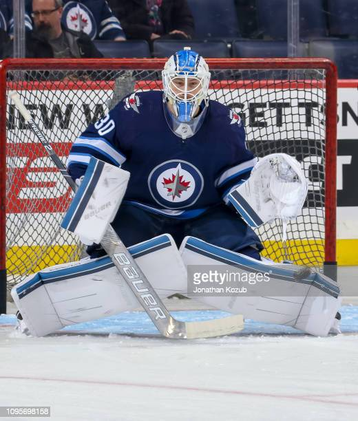 Goaltender Laurent Brossoit of the Winnipeg Jets takes part in the pregame warm up prior to NHL action against the Anaheim Ducks at the Bell MTS...