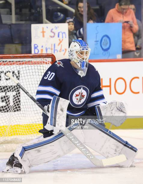 Goaltender Laurent Brossoit of the Winnipeg Jets takes part in the pregame warm up prior to NHL action against the Columbus Blue Jackets at the Bell...