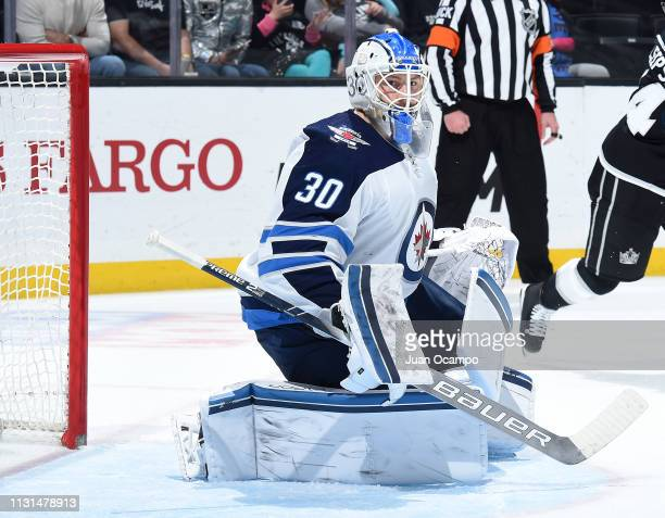 Goaltender Laurent Brossoit of the Winnipeg Jets tends net during the third period of the game against the Los Angeles Kings at STAPLES Center on...