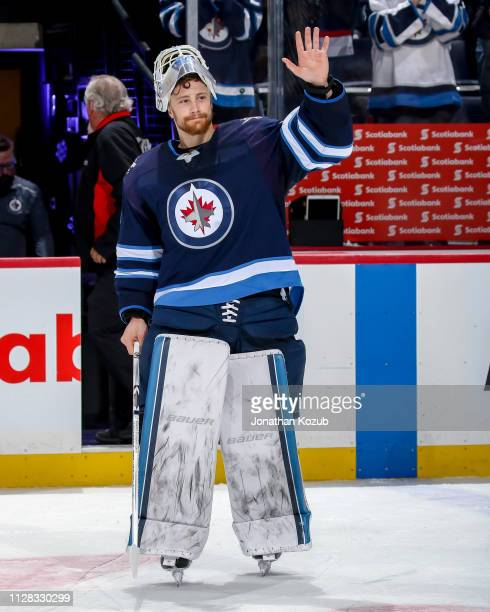 Goaltender Laurent Brossoit of the Winnipeg Jets waves to the crowd after receiving first star honours following a 53 victory over the Nashville...