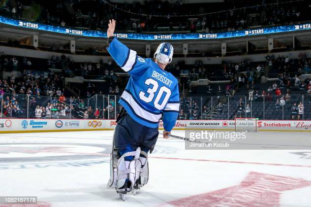 Goaltender Laurent Brossoit of the Winnipeg Jets waves to the fans after receiving first star honours following a 31 victory over the Carolina...