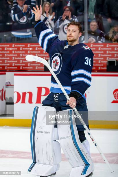 Goaltender Laurent Brossoit of the Winnipeg Jets waves to the fans after receiving first star honours following a 41 victory over the Vegas Golden...