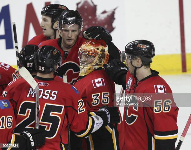 Goaltender Leland Irving gets encouragement from teammates including David Moss and Matt Pelech after the Calgary Flames 4 1 loss to the Edmonton...
