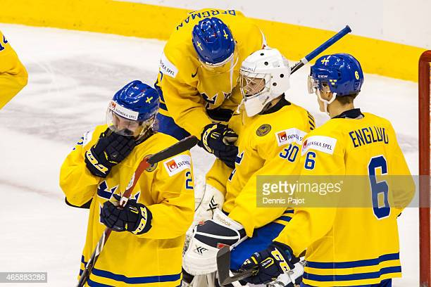 Goaltender Linus Soderstrom of Sweden is consoled by teammate Julius Bergman after a 41 loss to Russia during the semifinal game during the 2015 IIHF...