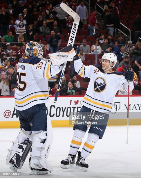 Goaltender Linus Ullmark and Nathan Beaulieu of the Buffalo Sabres celebrate after defeating the Arizona Coyotes in the NHL game at Gila River Arena...