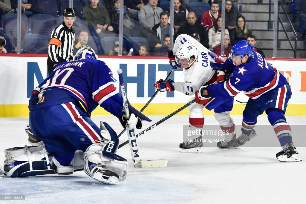Goaltender Linus Ullmark #30 defends his net as Daniel Carr #11 of the Laval Rocket skates the puck against Conor Allen #7 of the Rochester Americans during the AHL game at Place Bell on October 25, 2017 in Montreal, Laval, Canada. The Rochester Americans defeated the Laval Rocket 5-2.