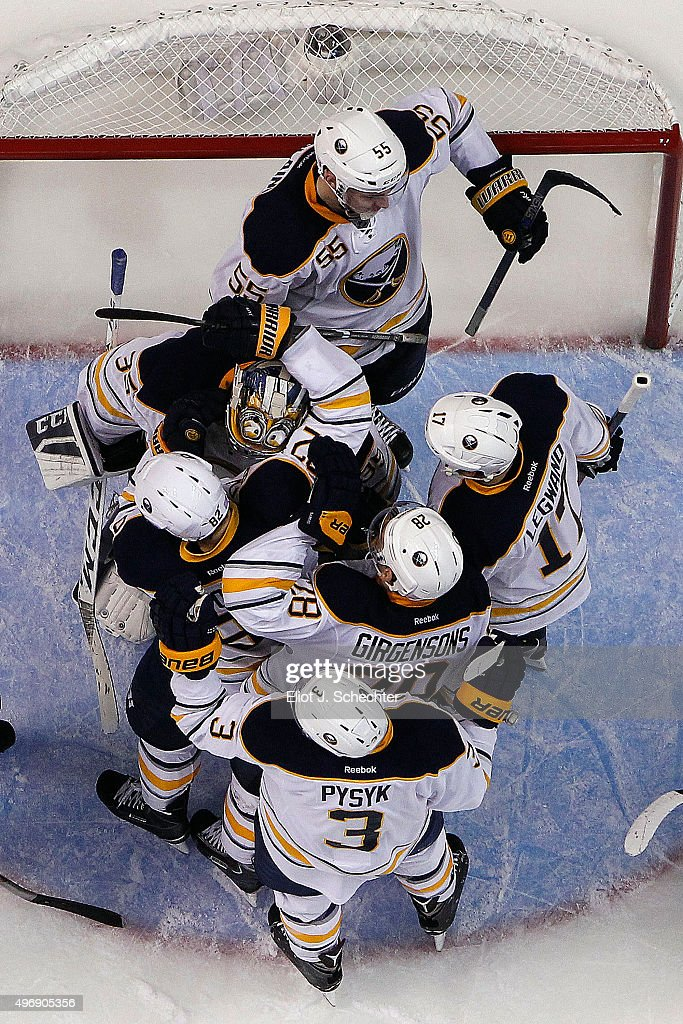 Goaltender Linus Ullmark #34 of the Buffalo Sabres is swarmed by teammates while they celebrate their 3-2 win against the Florida Panthers at the BB&T Center on November 12, 2015 in Sunrise, Florida.