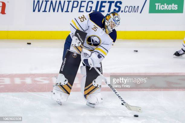 Goaltender Linus Ullmark of the Buffalo Sabres takes part in the pregame warm up prior to NHL action against the Winnipeg Jets at the Bell MTS Place...