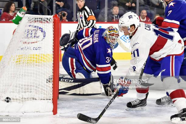 Goaltender Linus Ullmark of the Rochester Americans looks behind him as the puck enters the net against the Laval Rocket during the AHL game at Place...