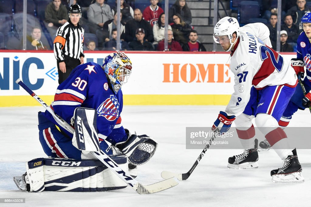 Goaltender Linus Ullmark #30 of the Rochester Americans makes a pad save near Peter Holland #27 of the Laval Rocket during the AHL game at Place Bell on October 25, 2017 in Montreal, Laval, Canada. The Rochester Americans defeated the Laval Rocket 5-2.