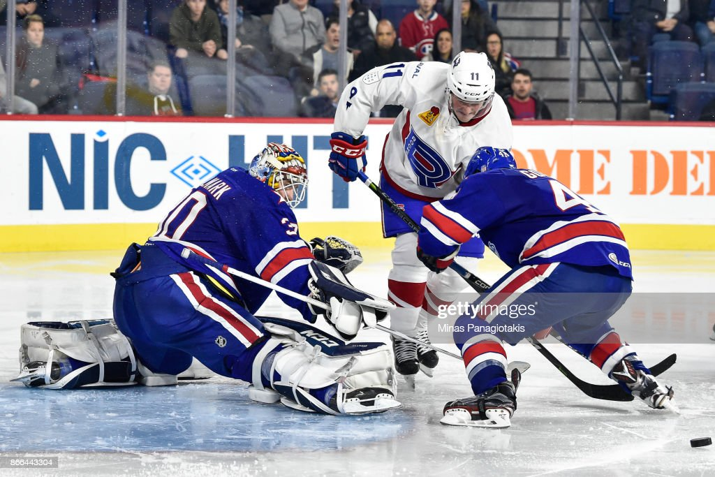 Goaltender Linus Ullmark #30 of the Rochester Americans makes a save near Daniel Carr #11 of the Laval Rocket during the AHL game at Place Bell on October 25, 2017 in Montreal, Laval, Canada. The Rochester Americans defeated the Laval Rocket 5-2.