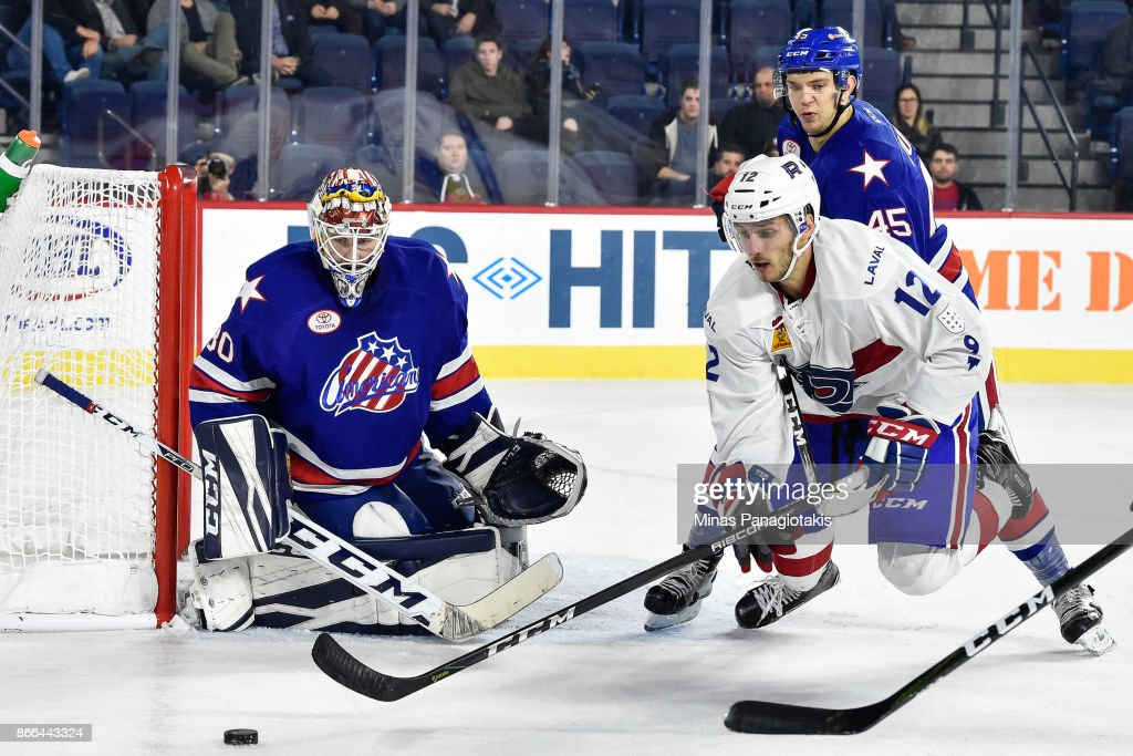 Goaltender Linus Ullmark #30 of the Rochester Americans protects his net as Kyle Baun #12 of the Laval Rocket chases the puck during the AHL game at Place Bell on October 25, 2017 in Montreal, Laval, Canada. The Rochester Americans defeated the Laval Rocket 5-2.