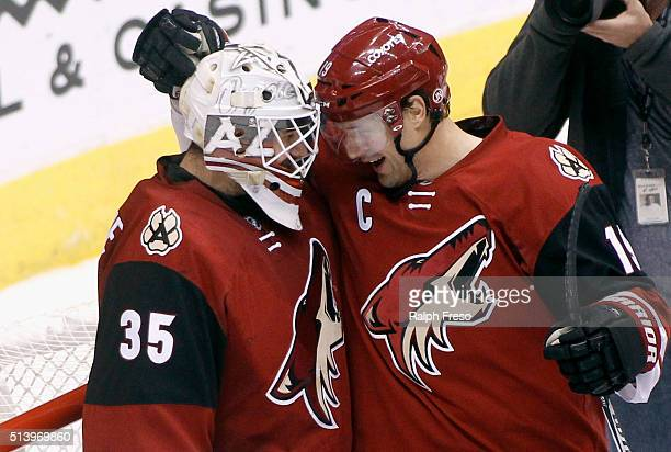 Goaltender Louis Domingue and Shane Doan of the Arizona Coyotes celebrate after a 51 victory against the Florida Panthers at Gila River Arena on...